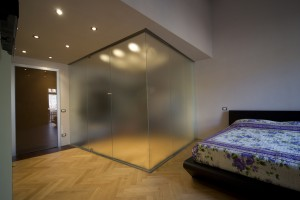 Creation of the wardrobe cabin in frosted glass in the bedroom