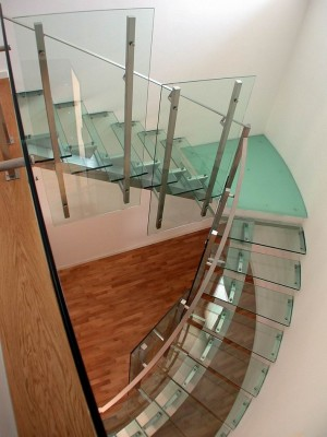 Stair consists of Steps and Railings in glass for residential