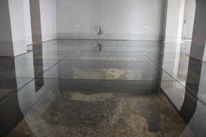 Glass flooring over archaeological finds of Etruscan and Roman