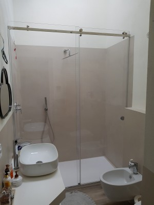 Box shower with sliding door and stainless steel accessories